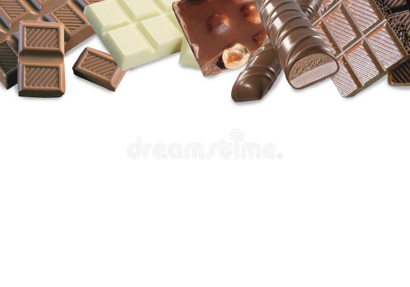 Variedades diferentes de chocolate Chocolate branco com avelã e arandos, leite e chocolate escuro com avelã fotos de stock royalty free