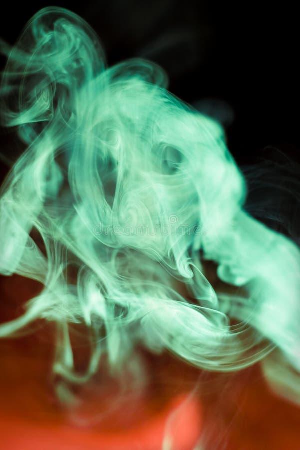 Variegated puffs of smoke stock photo