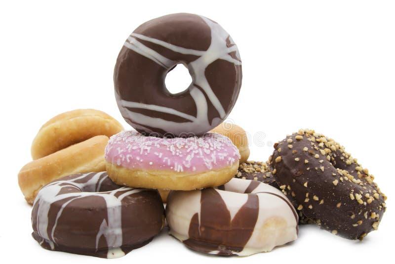 Varierande donuts staplade arkivfoton