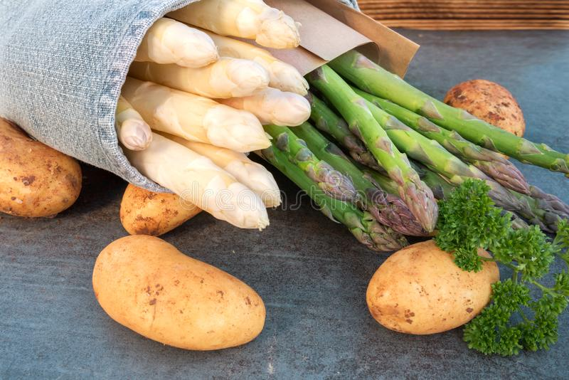 Varieties of asparagus with new potatoes stock photography