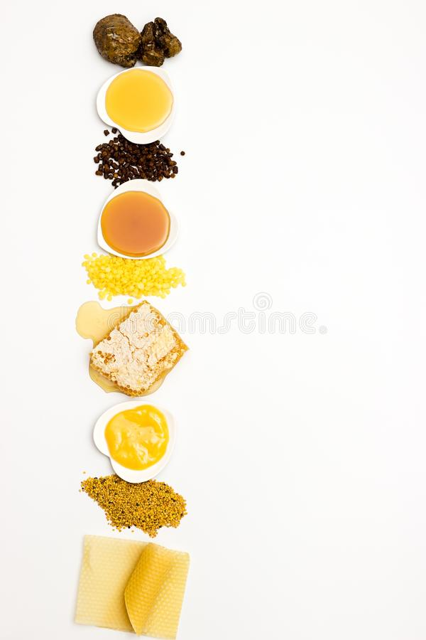 Variety of bee products. Various varieties of bee products on a white background stock photo