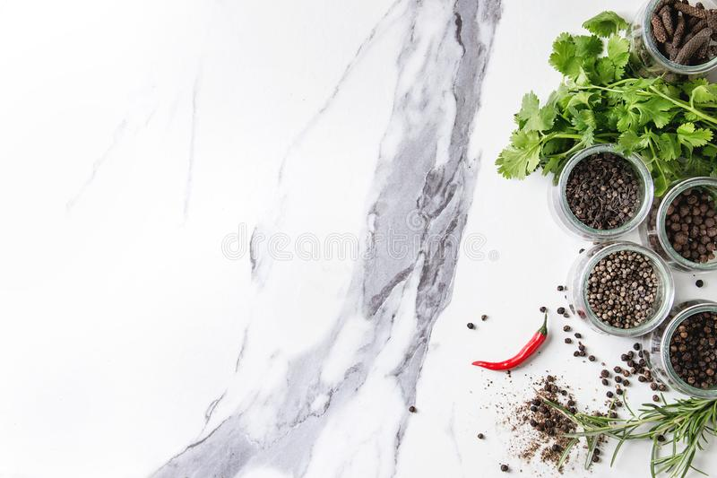 Variety of black peppers stock photography