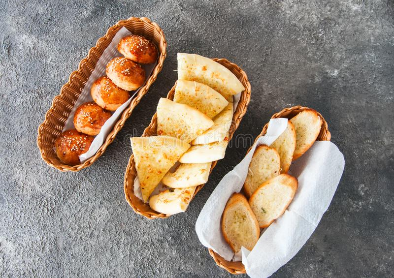 Variety bread snacks in a basket. Top view. stock photos