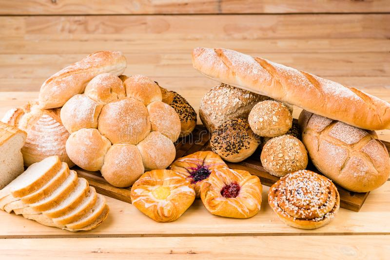 A variety of breads are arranged together, the appearance and color are different. Extremely appetizing stock photo