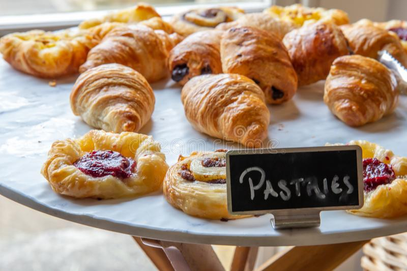 Variety of breakfast pastries. Assortment of french baked breakfast pastries royalty free stock photo
