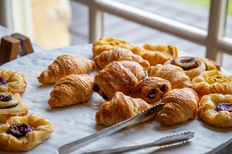 Variety of breakfast pastries. Assortment of french baked breakfast pastries stock photography