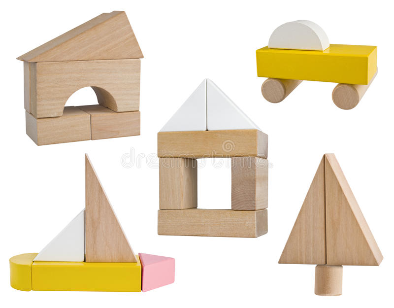 Variety of business symbols build from wooden toy blocks royalty free stock photography