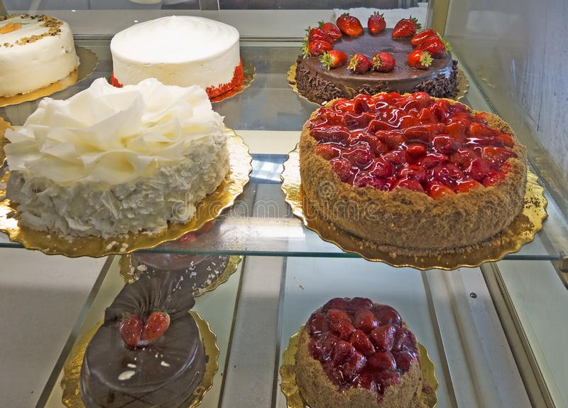 Variety of cakes on display stock photos