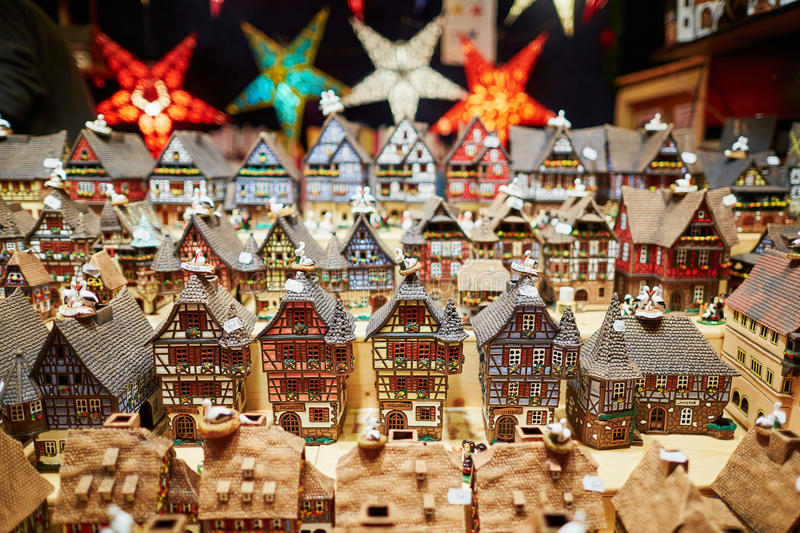 Variety of ceramic houses and star garlands at traditional Christmas market in Strasbourg royalty free stock images