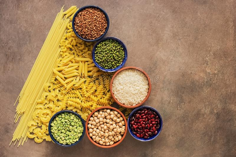 A variety of cereals, legumes and pasta in the form of an abstract Christmas tree. Top view, flat lay, copy space stock photography