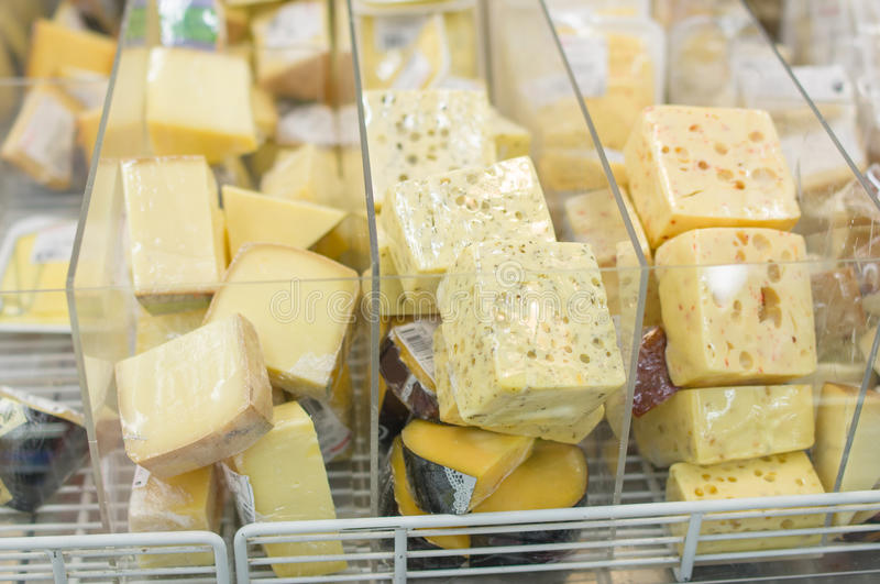 Variety of cheese pieces in supermarket stock photography