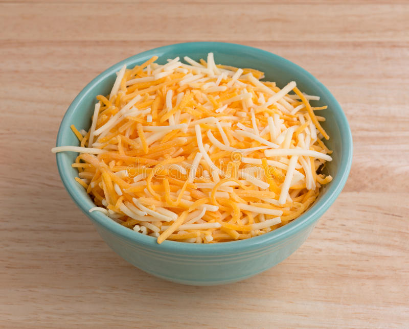 Variety of cheeses in a small bowl stock image