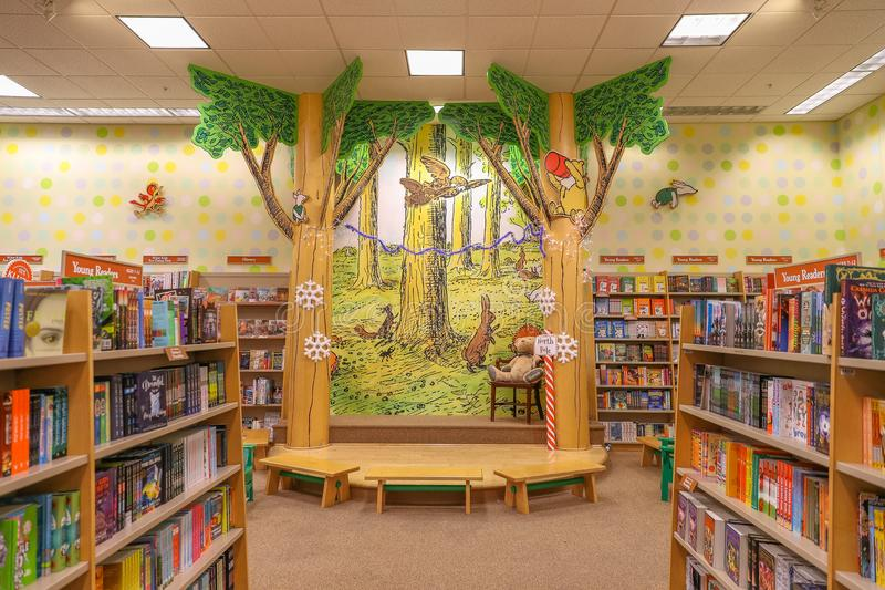 A variety of children`s books are placed on the shelves of the bookstore. Philadelphia, Pennsylvania December 12 2017: A variety of children`s books are placed stock photography