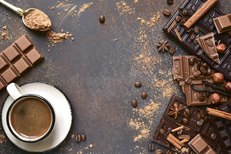 Variety of chocolate bars with spices.Top view. Variety of chocolate bars with spices on an old rusty metal background.Top view stock images