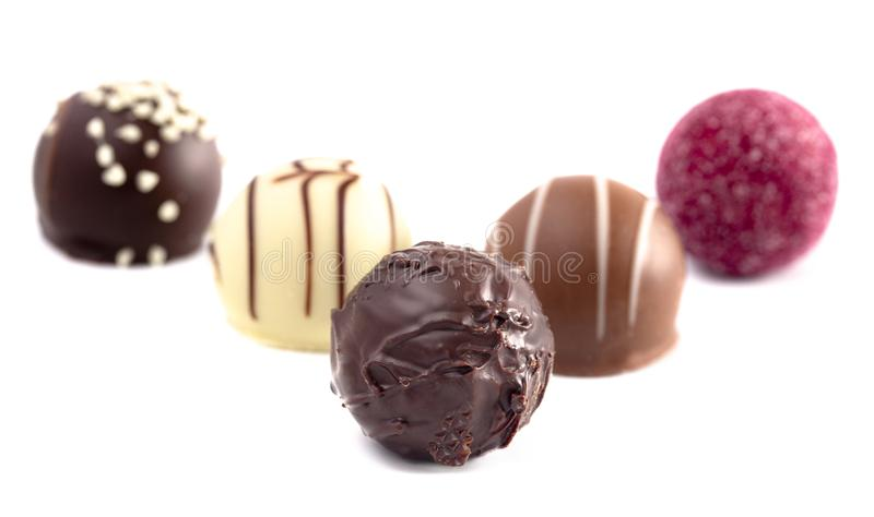 Variety of Chocolate Truffles Isolated on a White Background. A Variety of Chocolate Truffles Isolated on a White Background royalty free stock photos