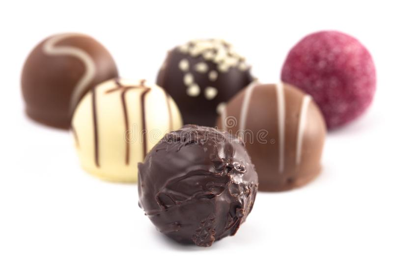 Variety of Chocolate Truffles Isolated on a White Background. A Variety of Chocolate Truffles Isolated on a White Background royalty free stock photo