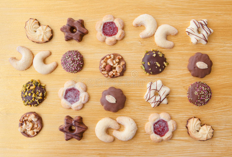 Variety of christmas cookies. On golden background royalty free stock photos