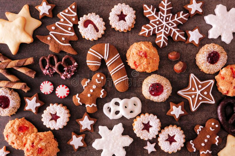 Variety of Christmas cookies and baked sweets, top view over a dark stone background. Variety of Christmas cookies and sweets. Top view over a dark stone royalty free stock images