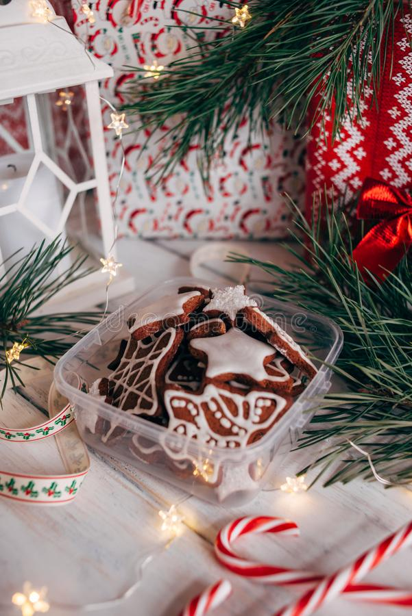 A variety of Christmas gingerbread cookies are laid out on a white wooden background stock images