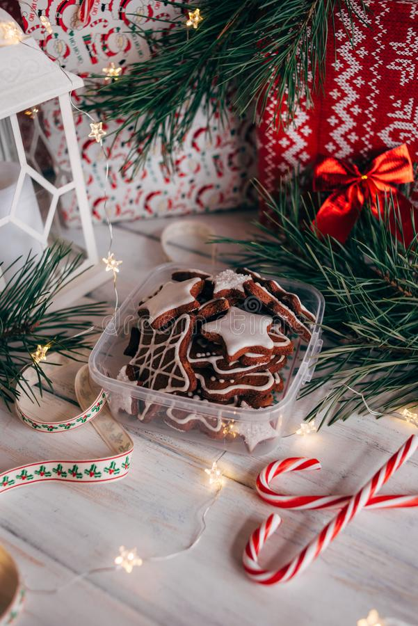 A variety of Christmas gingerbread cookies are laid out on a white wooden background. Toning royalty free stock image