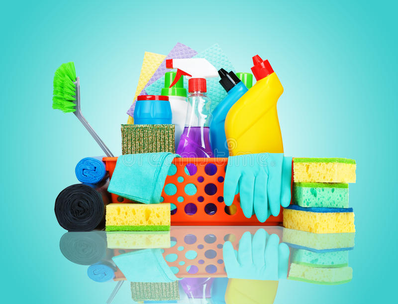 Variety of cleaning supplies in a basket. Cleaning supplies in a basket - cleaning and housekeeping concept stock photos