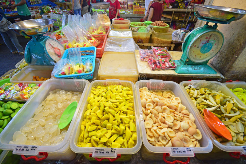 Variety of Close up Fruit pickles sold in Pulau Penang with two Large Weighing Machine royalty free stock image