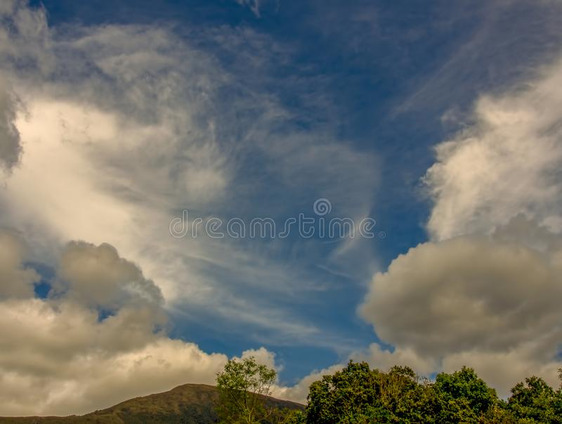 A variety of clouds over the Andean mountains. Multiple exposure of a variety of clouds over the Andean mountains of central Colombia royalty free stock photos