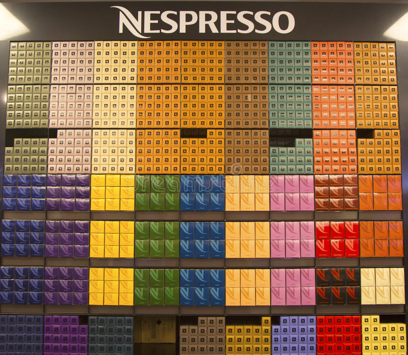 Variety of coffee capsules in Nespresso store stock image