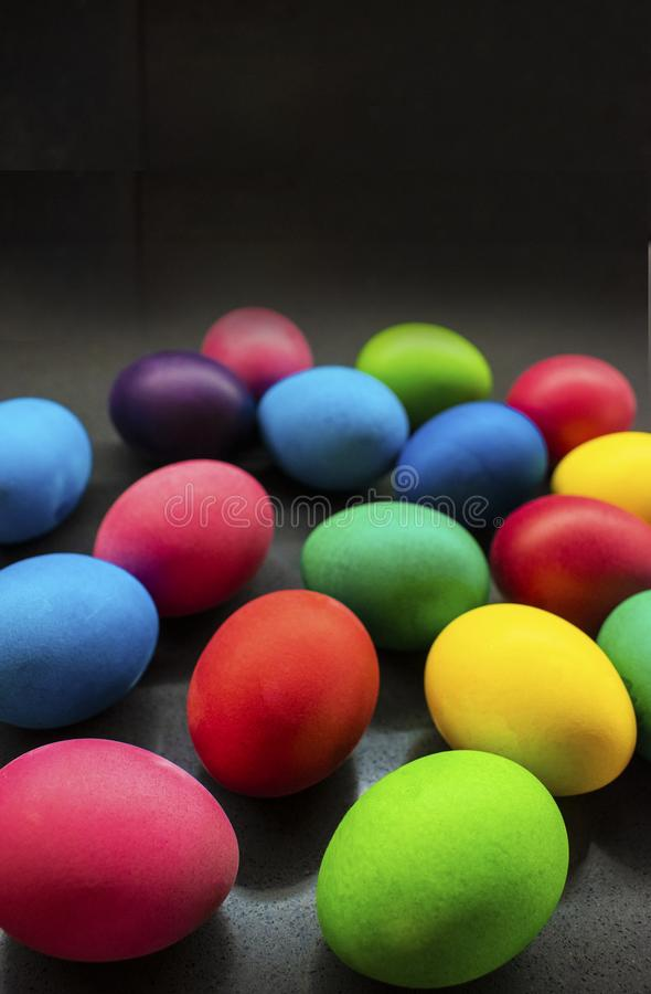 Variety of painted Easter eggs on black background stock photography