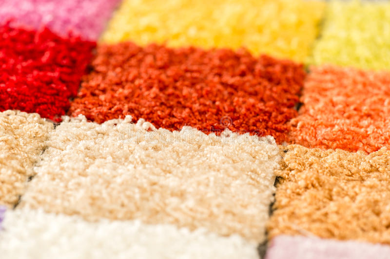 A variety of colorful carpet swatches. A selection of colorful carpet swatches stock photo