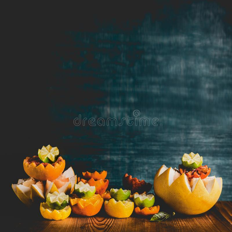 Variety of colorful citrus fruits half on table at dark background. Copy space. Tropical citrus fruits assortment. Vitamin C. Healthy lifestyle royalty free stock photo