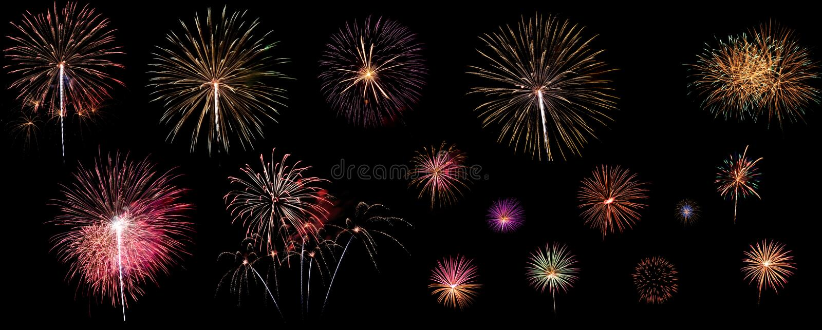 A variety of colorful fireworks isolated on black background royalty free stock images