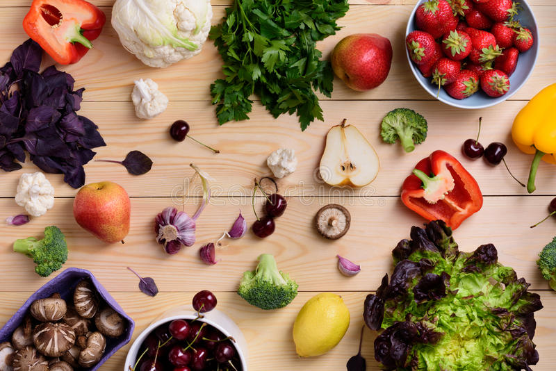Variety of colorful fruits, vegetables and berries. Healthy diet concept. Vegetarian organic food set over wooden table. Top royalty free stock photos