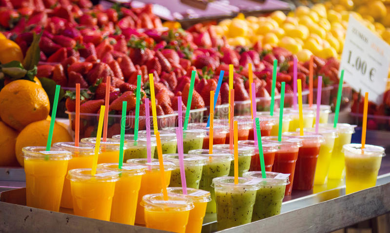 Download Variety Of Colorful, Fruity Drinks On Ice At Market Stock Photo - Image: 83723584