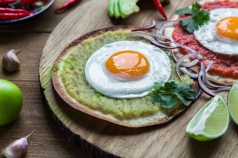 Variety of colorful mexican cuisine breakfast dishes on a wooden table. Variety of colorful mexican cuisine breakfast dishes on a table royalty free stock image