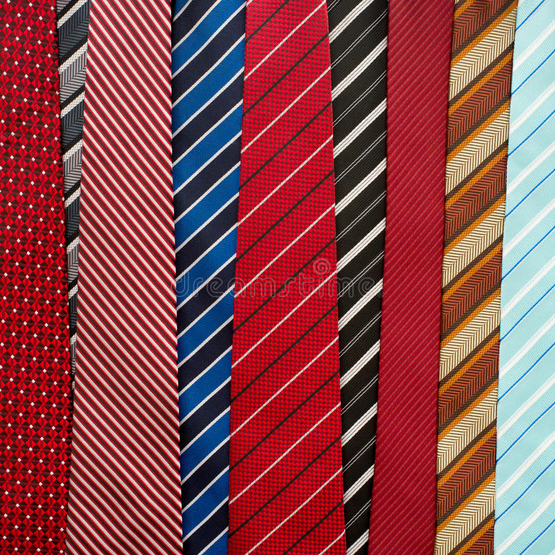 Variety of colorful neckties. In the market stock photos