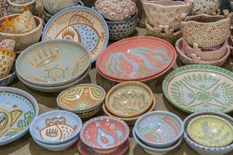 Variety of Colorfully Painted Ceramic Pots in an Outdoor Shopping Market. pottery in the shop window.  stock photos