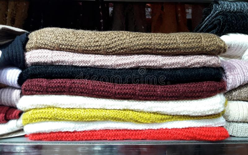 Variety colors of napery clothes arranged on selves, Decoration. royalty free stock photography