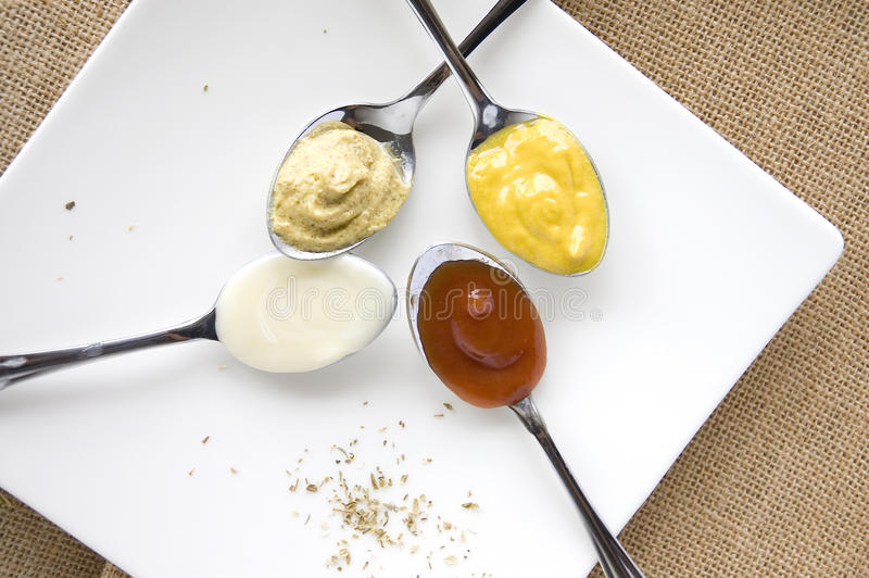 Variety of condiments stock images