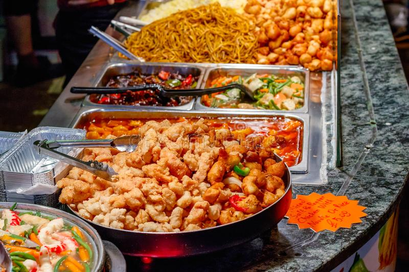 Variety of cooked Chinese food on display for takeaway at Camden market in London. UK stock image