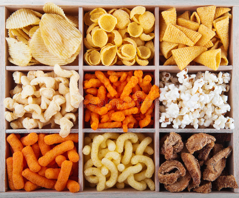 Variety of crunchy snacks stock image. Image of chips