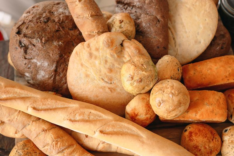 Variety of different fresh bread. Buns and loaves of bread. royalty free stock photo