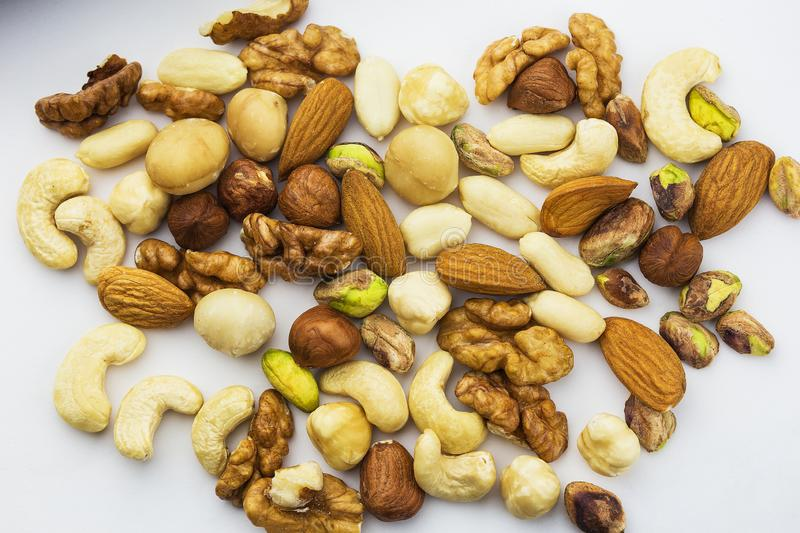A variety of different kinds of useful nuts on a white background stock photography