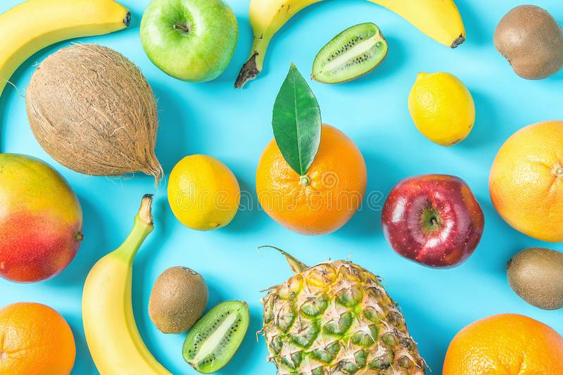 Variety of Different Tropical and Seasonal Summer Fruits. Pineapple Mango Coconut Oranges Lemons Apples Kiwi Bananas Pattern. Variety of Different Tropical and royalty free stock images