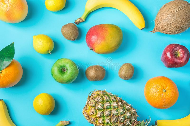Variety of Different Tropical and Seasonal Summer Fruits. Pineapple Mango Coconut Oranges Lemons Apples Kiwi Bananas Scattered. Variety of Different Tropical and stock photos