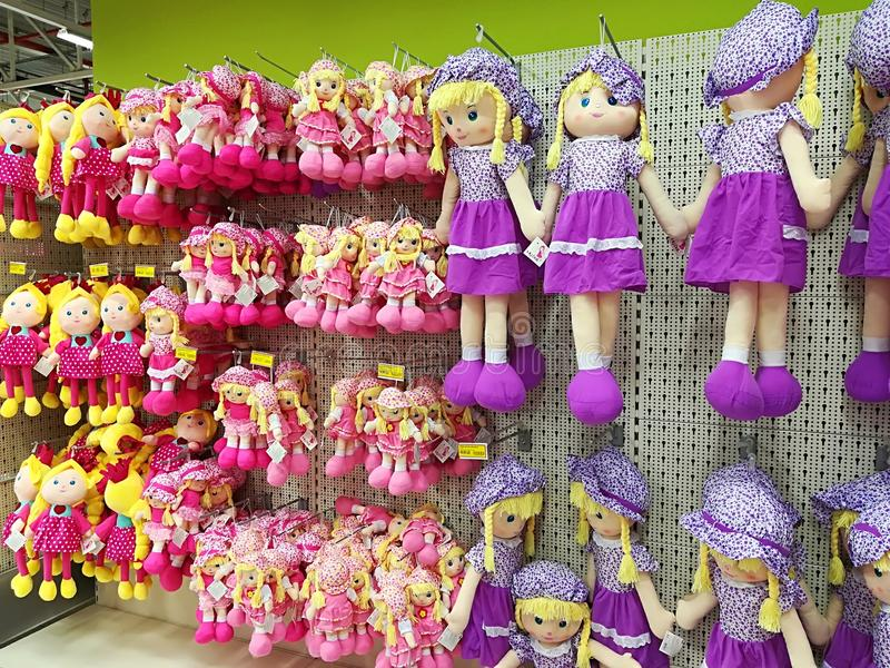 Variety of dolls at Jumbo store stock photography