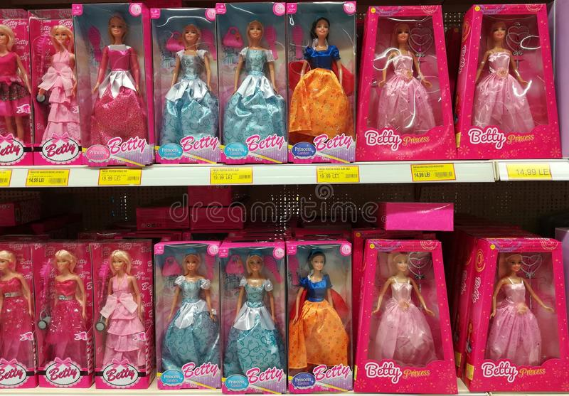 Variety of dolls at Jumbo store stock image