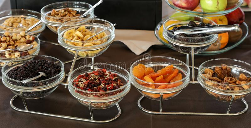 Variety of dried berries and fruits for healthy breakfast buffet table in greek hotel royalty free stock photography