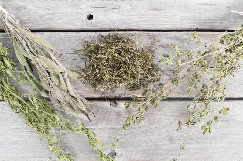 Variety of dried herbs. On wooden table stock images