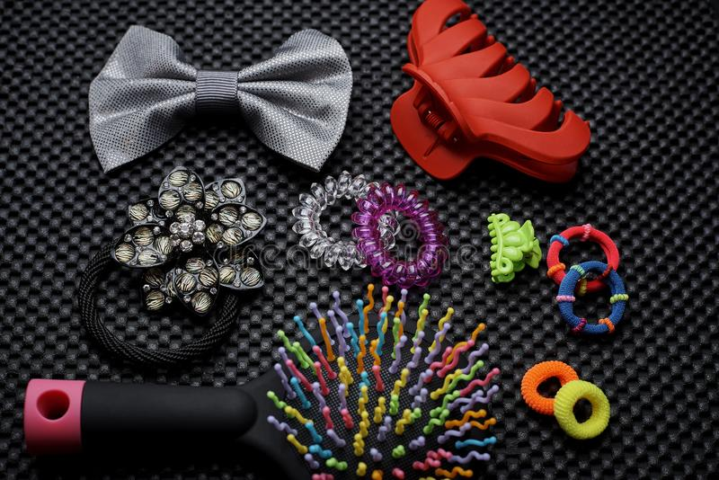 A variety of elastic bands, hairpins with a bright multi-colored comb stock image